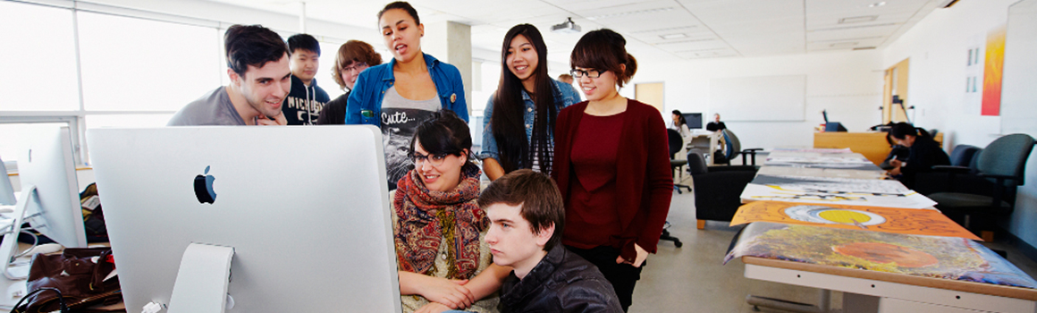 Students around a computer monitor
