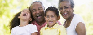 Photo of grandparents and two grandchildren laughing