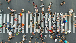 Aerial image of a crosswalk and people crossing the street